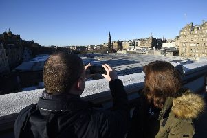 Tourists on the Bridges looking to Princes Street. Pic: Greg Macvean