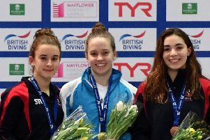 Millie Fowler on the podium after winning the Women's 3m Final. Picture: Harry Trump/Getty Images