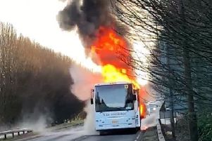 E&M Horsburgh coach catches fire.  Horsburgh are a bus hire company that have the contracts for several schols in the Lothians Picture sent in by passenger on A71 by bells Quarry