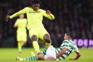 Darnell Johnson fouls Celtic's Emilio Izaguirre during the recent clash at Parkhead. Picture: SNS
