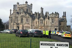 There was a large police presence outside of Muirhouse Mansion. Pic: Lisa Ferguson