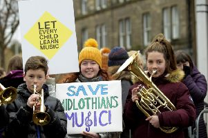 A musical flash mob gathered on Tuesday outside the council chambers in Dalkeith. Pic: Lisa Ferguson
