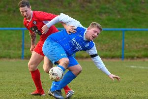 Callum Connolly (in red) tries to get around Dale Richardson when playing for Newtongrnage