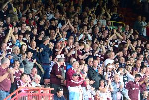 Hearts fans in the away stand at Partick Thistle. Picture: SNS