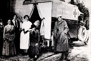 The picture, entitled 'John Patrick,' was taken outside Royaumont Hospital, France in December 1914.  Obstetrician Frances Ivens & actress Cicely Hamilton are among the team pictured.