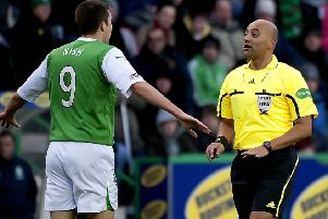 Maltese referee Christian Lautier has words with Hibs striker Colin Nish in November 2010. Picture: SNS Group