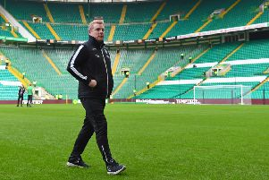 Neil Lennon walks on the Parkhead turf ahead of Celtic's match with Hibs in January 2018. Picture: SNS Group