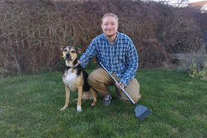 Greg Mahoney, who has launched Super Pet Scooper in East Lothian, with his rescue dog Rocco