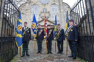 Royal Scots standard bearers outside before the Royal Scots Club commemorative church service at Canongate Kirk, Edinburgh.