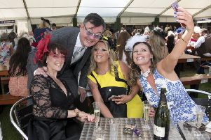 Horse Racing, Musselburgh Ladies Day. Grant Stott gets in on the action with left to right Lisa Wann, Lee Archibald and Julie Mitchell.