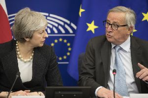 Prime Minister Theresa May and European Commission President Jean-Claude Juncker. (AP Photo/Jean-Francois Badias)