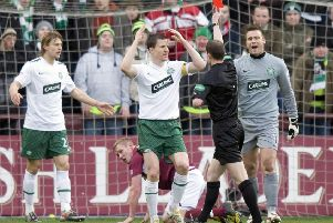 Celtic's Gary Caldwell is shown the red card by referee Willie Collum after foul on Hearts ace Jamie Mole. Picture: SNS/Craig Williamson
