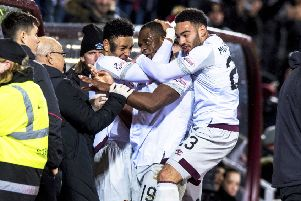 Uche Ikpeazu (centre) celebrates with the dugout after equalising for Hearts