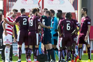Hearts' Callum Paterson receives a red card from Willie Collum the last time the team lost at Hamilton. Picture: SNS/Sammy Turner