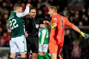 Hibernian's Florian Kamberi and Hearts' Zdenek Zlamal exchange words as referee Andrew Dallas intervines. Picture: SNS/Ross Parker