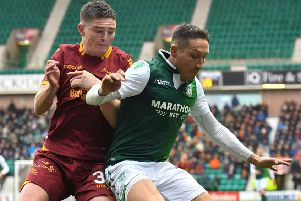 Mark Milligan holds off Motherwell's Jake Hastie during a fine display at centre-back