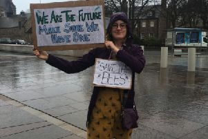 Harriet Sweatman protests against climate change outside the Scottish Parliament