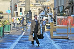 Pedestrians on traffic-free sections of George Street, Edinburgh. Picture: Jane Barlow/TSPL