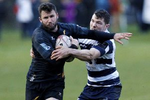 Heriots' Ross Jones tackles Currie's Joe Reynolds. The two teams meet this weekend. Pic: SNS
