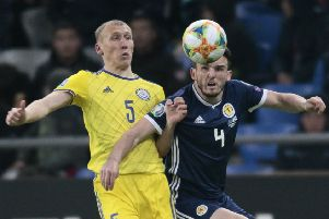 John McGinn wins the ball in midfield against Kazakhstan. He says players are to blame for the loss, not Alex McLeish. Picture: AP Photo/Alexei Filippov