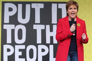 First Minister of Scotland Nicola Sturgeon addresses anti-Brexit campaigners in Parliament Square as they take part in the People's Vote March in London. Pic: Yui Mok/PA Wire