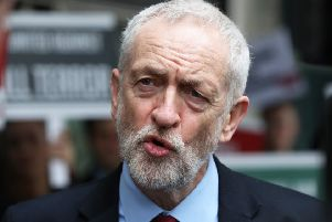 Jeremy Corbyn and Theresa May should be talking about ways to end the Brexit impasse. Picture: Jonathan Brady/PA Wire