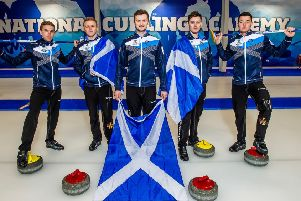 Bruce Mouat is flanked by his team who begin their bid against Russia on Saturday. Pic: Alan Peebles
