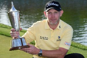 Stephen Gallacher shows off the trophy after his win in the Hero Indian Open in New Delhi. Picture: Getty Images