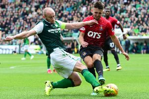 David Gray (left) competes with Kilmarnock's Greg Taylor during Hibs' 3-2 win back in September. Picture: SNS