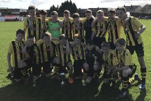 Hutchison Vale Colts Under-14s show off the David Innes Cup after beating Redhall Star