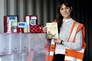 Rachel Vette with some of the free sanitary products available. Picture: Lisa Ferguson/TSPL