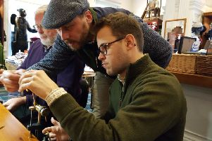 Lee Currie (standing teaching fly-tying during one of the free sessions held at Orvis in Edinburgh. Picture: Nigel Duncan
