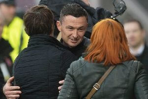Hibs head coach Paul Heckingbottom is congratulated by chief executive Leeann Dempster after defeating Hearts. Pic: SNS