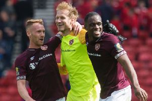 Hearts goalkeeper Zdenek Zlamal, centre, made an incredible save at 1-0. Pic: SNS