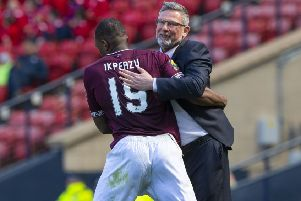Hearts' Uche Ikpeazu celebrates with manager Craig Levein after opening the scoring. Pic: SNS/Alan Harvey