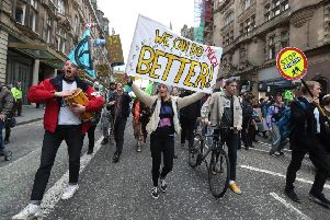 Climate protesters join Extinction Rebellion Scotland as they form a road block on the North Bridge. Picture: Andrew Milligan/PA Wire
