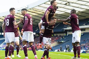 Hearts' Sean Clare shakes hands with Steven MacLean, as Olly Lee celebrates with Bobby Burns and Uche Ikpeazu