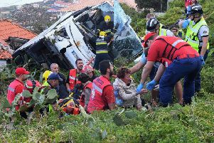 Firemen help victims of a tourist bus that crashed on the Portuguese island of Madeira. Picture: Rui Silva