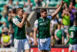 Paul Hanlon and Darren McGregor applaud the Hibs fans at full-time.