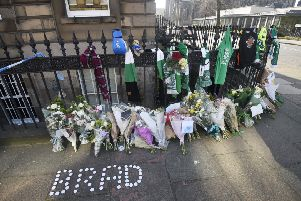 Floral tributes and Hibs scarves were left near the scene where Bradley Welsh was shot and killed on Chester Street. Picture: Greg Macvean