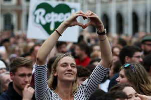 People celebrate at Dublin Castle as the official result of the abortion referendum is announced, in favour of repeal. Picture: PA