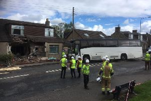 The driver of the single decker is said to have escaped with minor injuries in the accident in Main Street, East Whitburn. Picture: Ian Rutherford