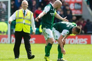 Hibs players David Gray and Mark Milligan rue a victory that got away.