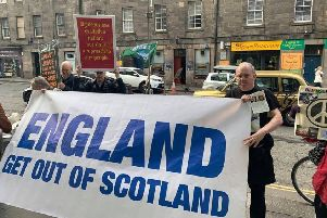 SNP delegates inside the EICC condemned the banner displayed outside