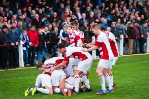 The Bonnyrigg Rose players celebrate after Dean Brett put them two goals up against Penicuik. Pictures: Ian Georgeson