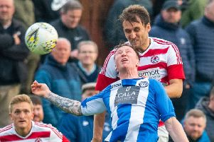Bonnyrigg defender Ewan Moyes wins a header during Wednesday's win. Pic: Ian Georgeson