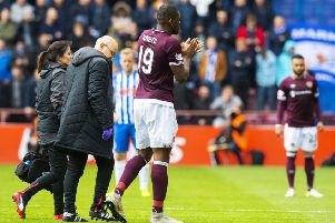 Uche Ikpeazu is taken off after picking up a hamstring injury. Pic: SNS