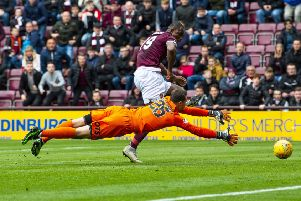Hearts Uche Ikpeazu misses a chance in the second half as Kilmarnock's Daniel Bachmann attempts to save. Pic: SNS