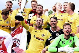 The Bonnyrigg players celebrate after being crowned East of Scotland League champions. Pic: Lisa Ferguson