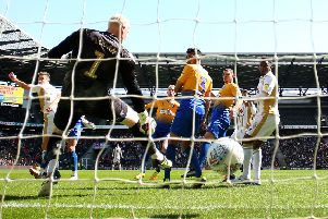 Conrad Logan is left helpless as MK Dons score to consign Mansfield to the play-offs. Pic: SNS